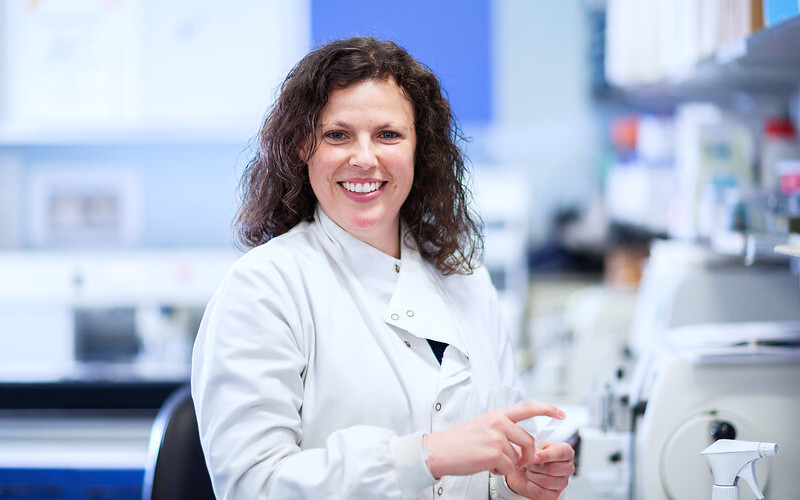 Woman working in lab smiling
