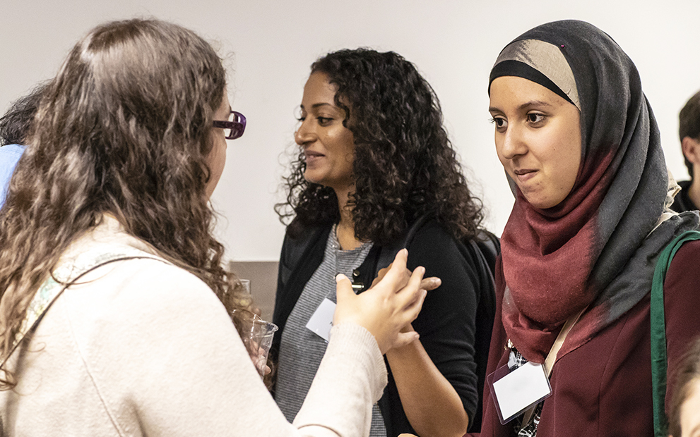 Staff talking at an event