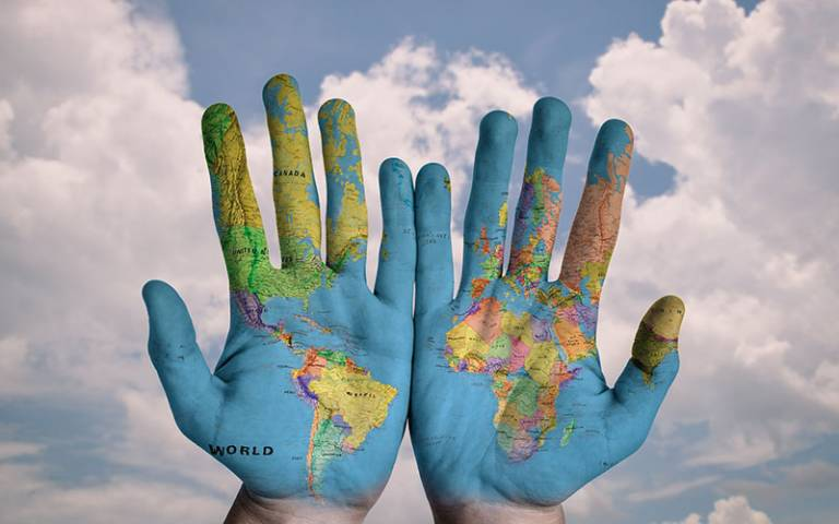 Hands with world map