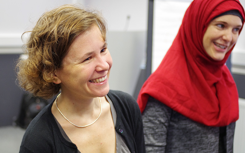 Two women laughing during a workshop