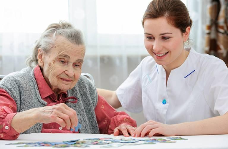 Elderly woman doing puzzle