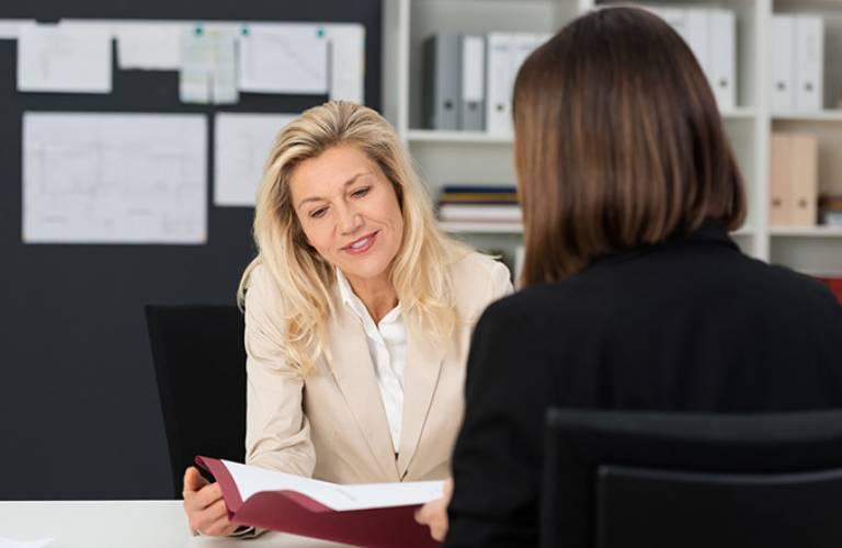 Women at work talking