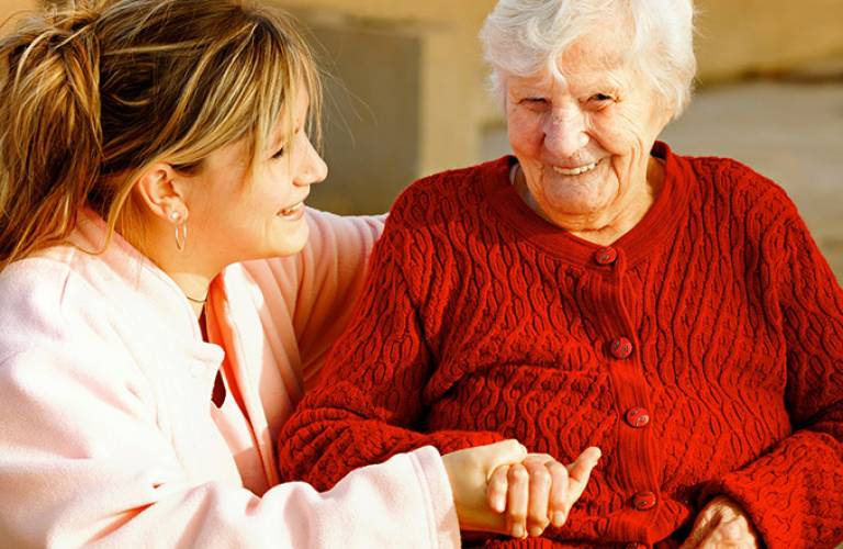 Older woman being helped by younger woman