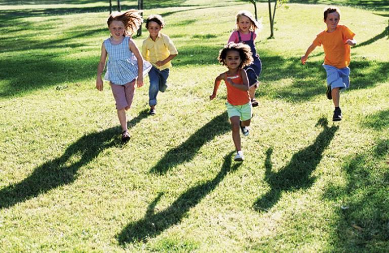 Children running across a field