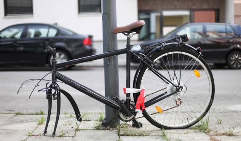 Locked bike with a wheel missing