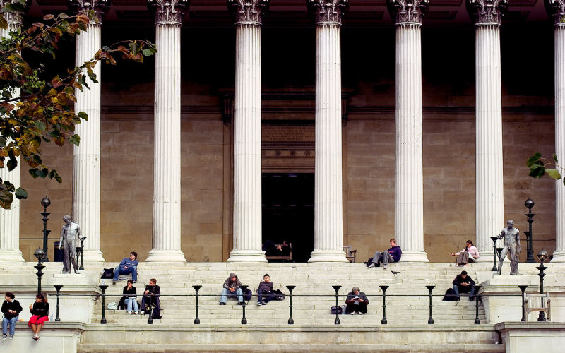 Image showing students sitting on steps of UCL's Main Building