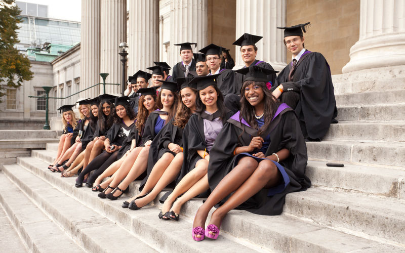 Image shows graduates sitting on steps of UCL's Main Building