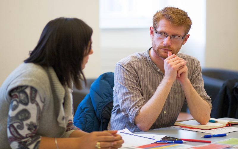Image of two members of staff talking in workshop