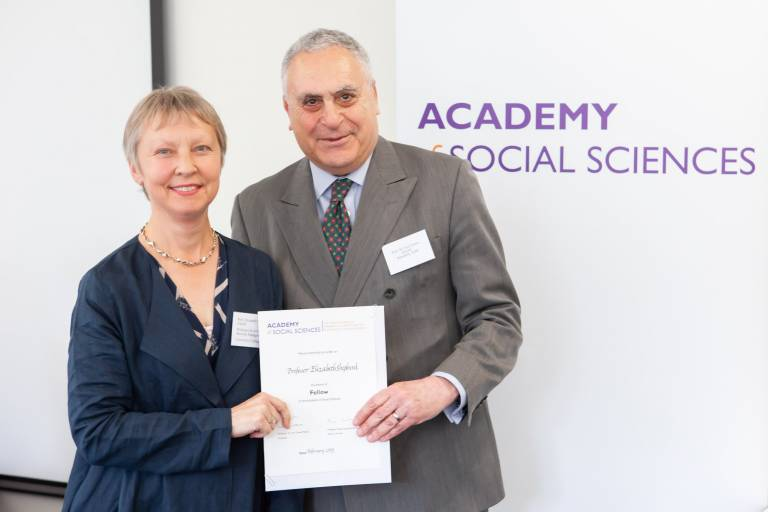 Professor Elizabeth Shepherd being awarded the Fellowship of the Academy of Social Sciences by its President, Professor Sir Ivor Crewe, at the AGM in London