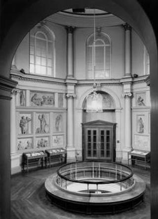 black and white interior photo of UCL's main library