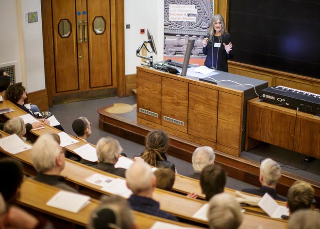 Woman presenting in a lecture theatre