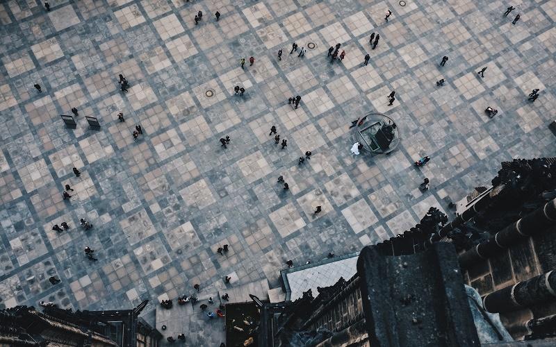 People in square in Prague, photo by Stijn te Strake on Unsplash