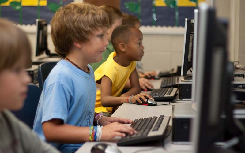 Boy in computer class