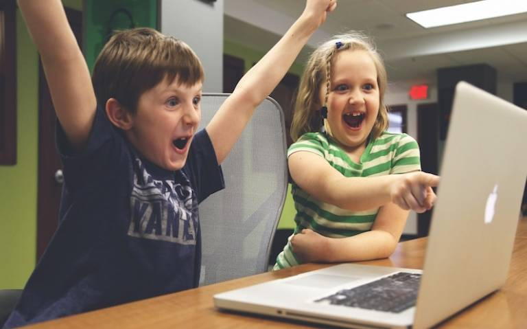 Excited children using computer