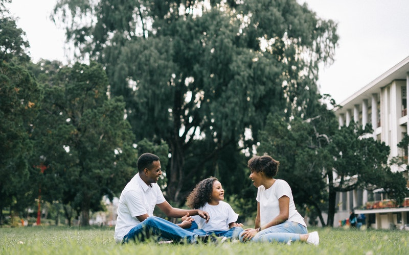 Family sitting on grass