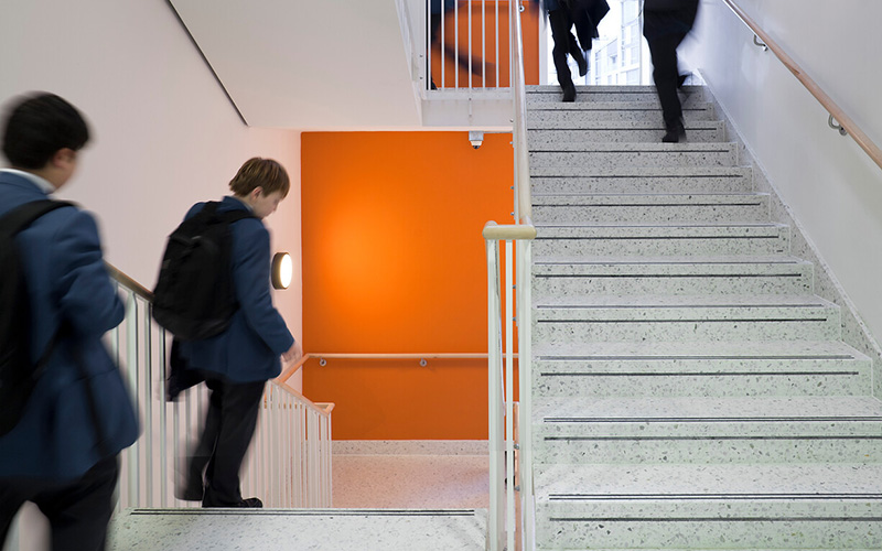 School students walking up and down stairs (Photo: UCL Digital Media)