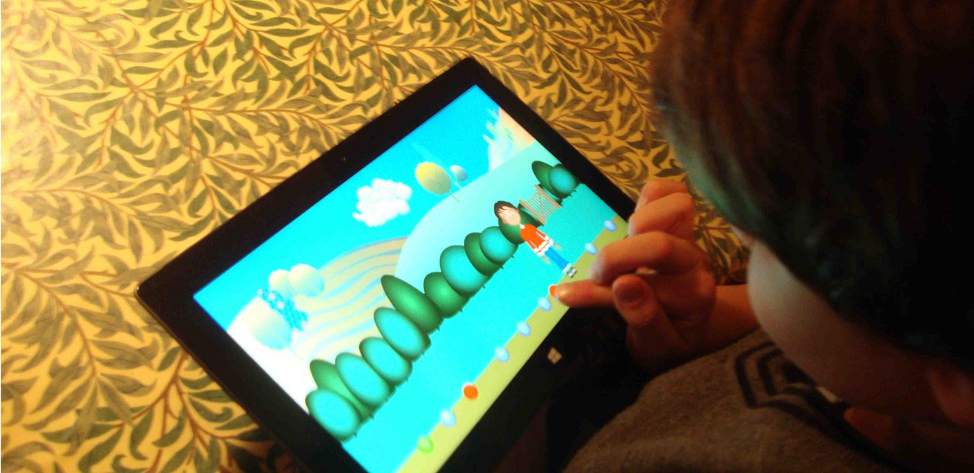 A child using the SHARE-IT game on a tablet device