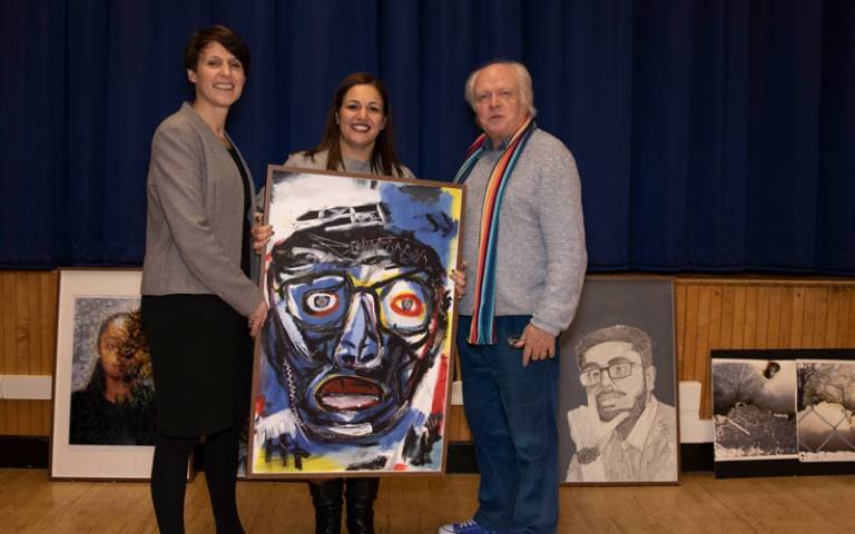 Andria Zafirakou, Becky Francis and Michael Attenborough with pupil's artwork