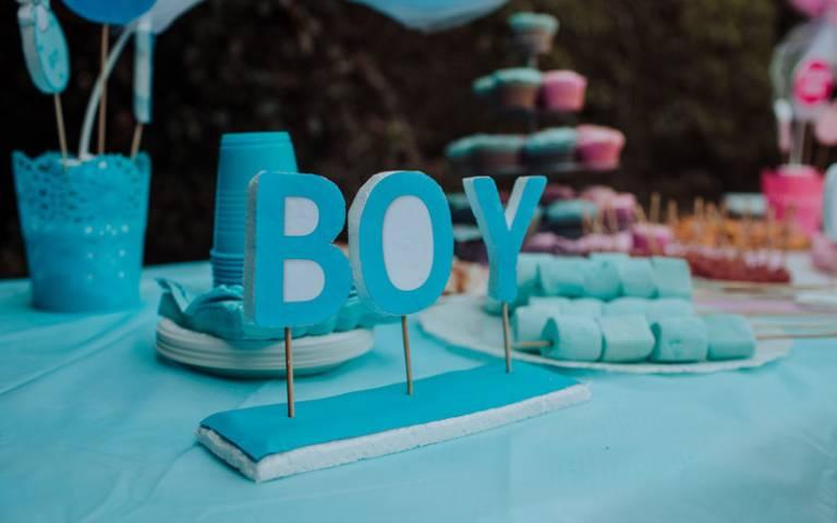 Baby reveal - letters spelling 'boy' in blue