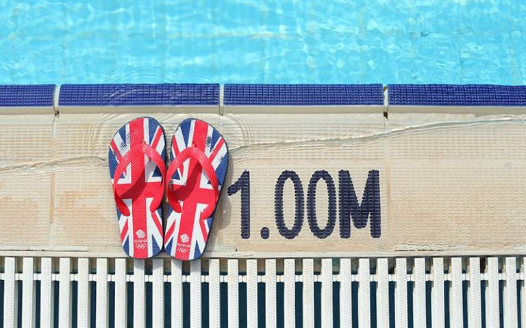 British flag print flip flops by a swimming pool