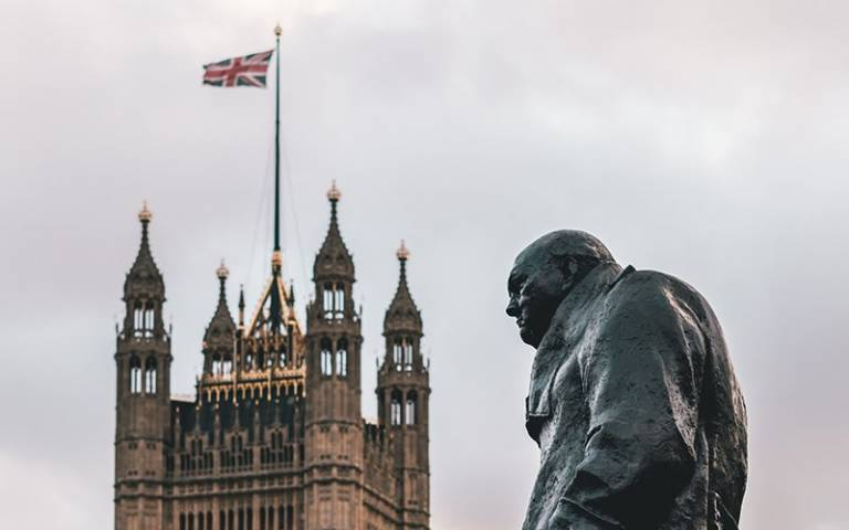 British flag and Winston Churchill statue