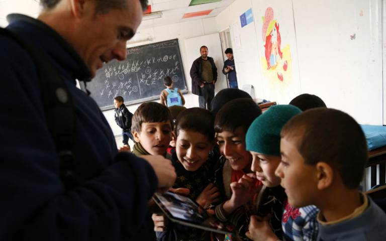 British teachers at refugee camp; Image: DFID - UK Department for International Development via Flickr (CC BY-NC 2.0)