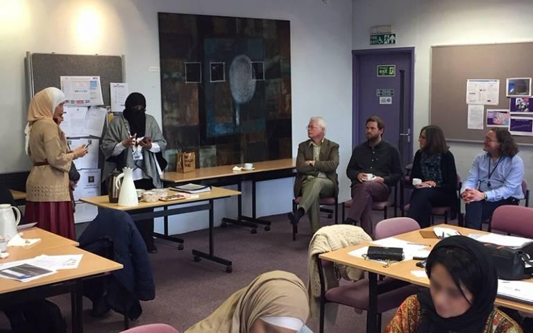 Women presenting at a seminar