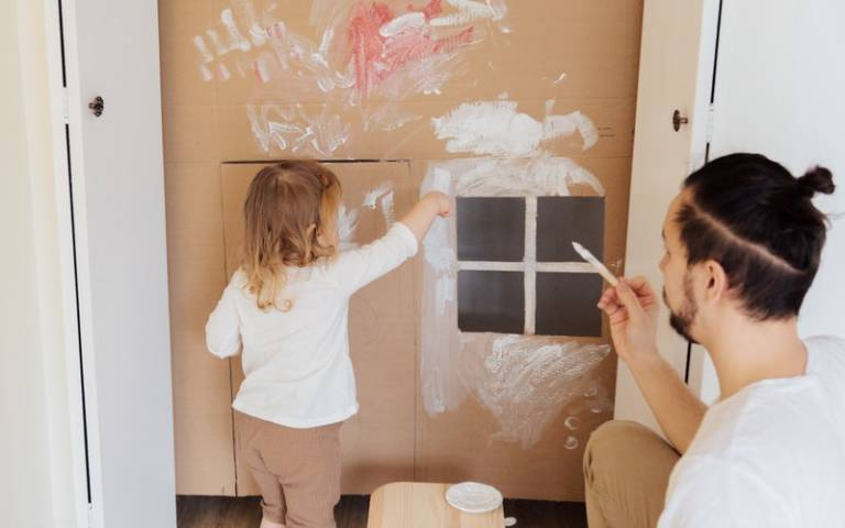 Child painting on cardboard. Image: Tatiana Syrikova via Pexels