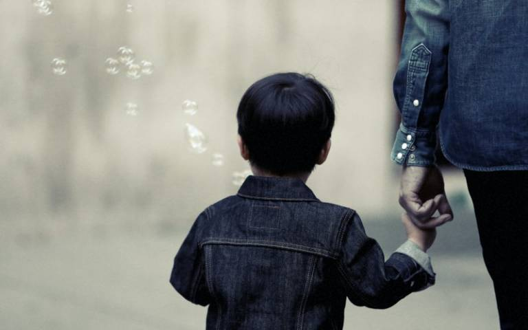 Child walking with their parent. Image: Life of Pix via Pexels