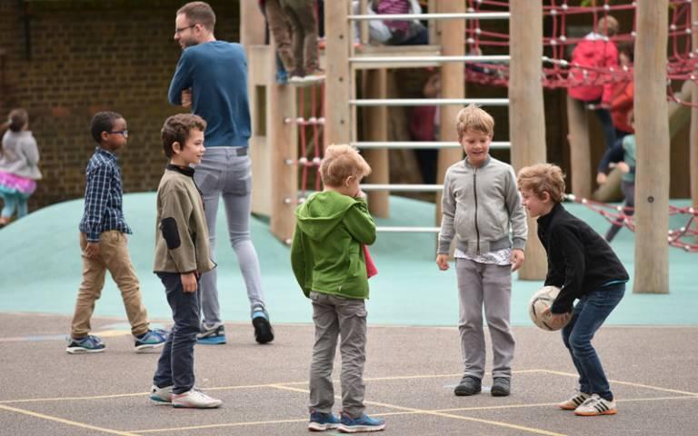 Children playing at break time in school