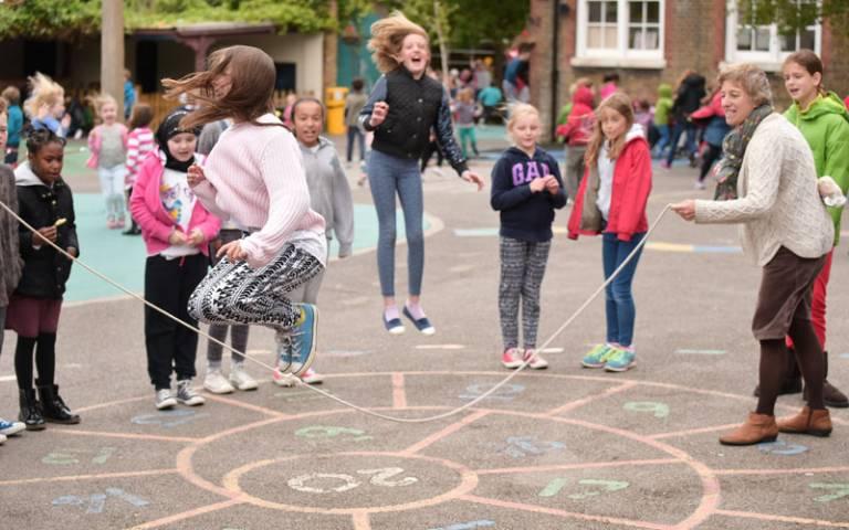 Children skipping in the school playground
