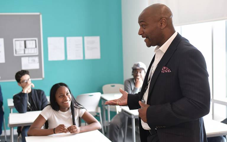 Teacher and pupils at Deptford Green School