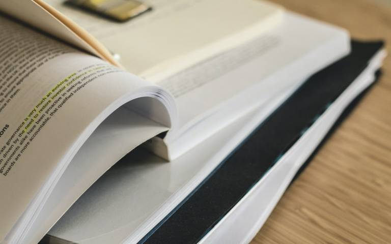 Book and research notes. Image: Lum3n via Pexels