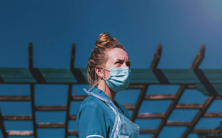 Care worker wearing mask. Image: Luke Jones via Unsplash