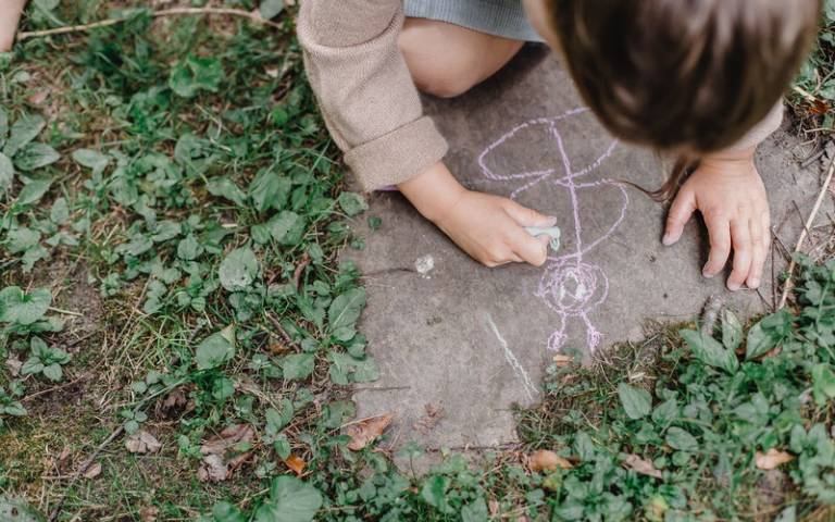 Child drawing on the floor in crayon. Image: Allan Mas via Pexels