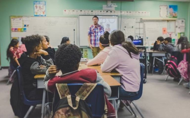 Teacher in front of class. Image: NeONBRAND on Unsplash