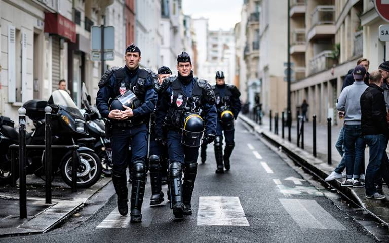 French anti-riot police walk down a Paris street. Credit: Kristoffer Trolle, via Flickr (CC BY 2.0)
