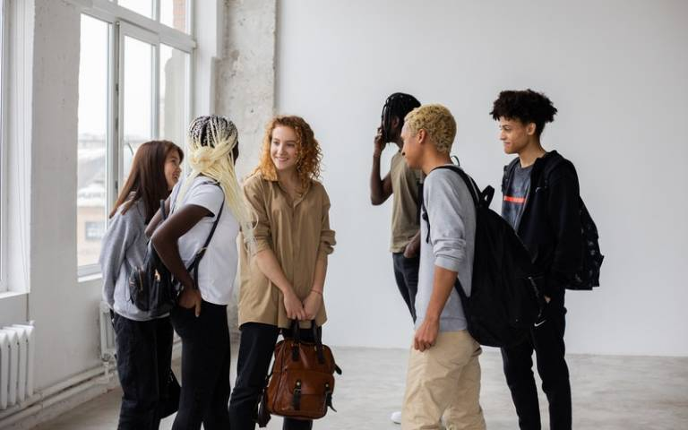 A diverse group of young people standing together. Image: Monstera via Pexels