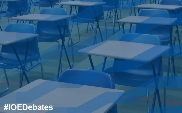 Rows of empty desks set up for exams in Portsmouth Grammar School (CC BY-SA 2.0 via Flickr)