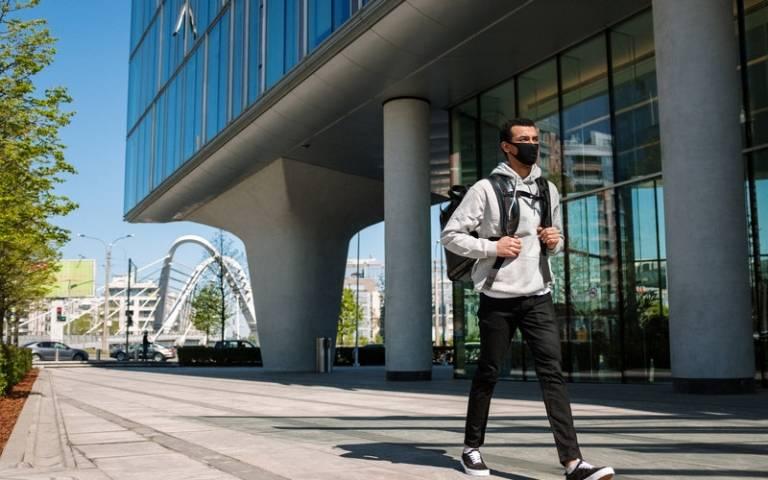 Man walking and wearing a mask. Image: cottonbro via Pexels