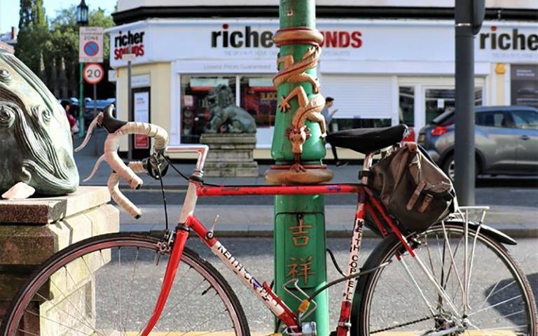 Bicycle rests on Chinese decorated lamp post in London. Image: Sofia Gomez Millington, China at Home category