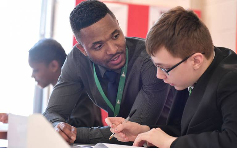 Teacher explaining to pupil, UCL Institute of Education