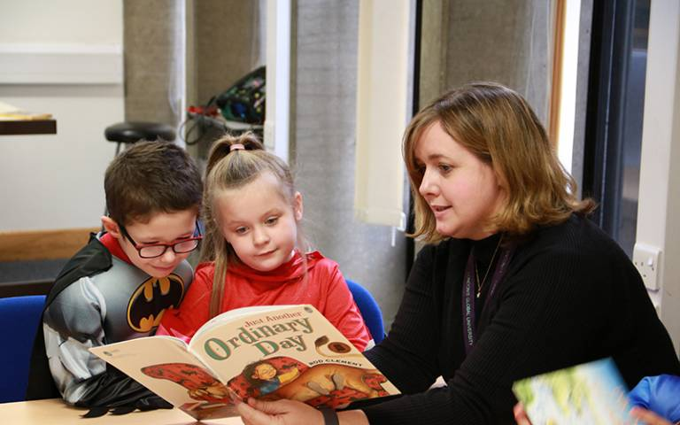 Teacher reading with students. Image: Sarah-Jane Gregori for UCL Institute of Education
