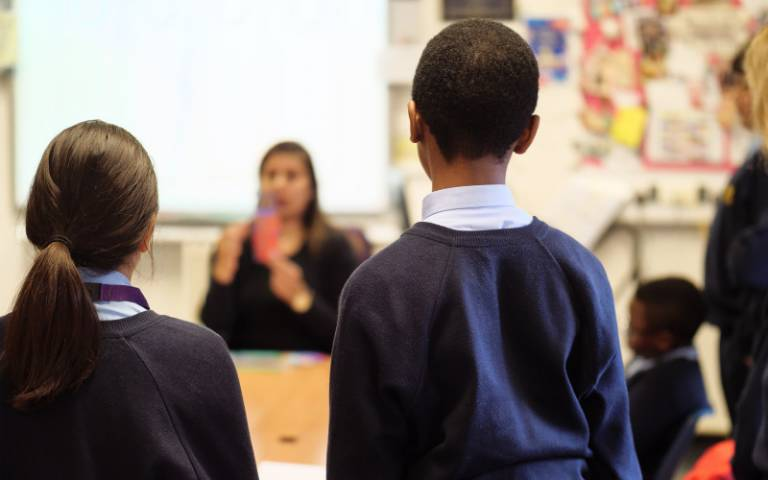 Two school children with teacher. Image: Phil Meech for UCL Institute of Education