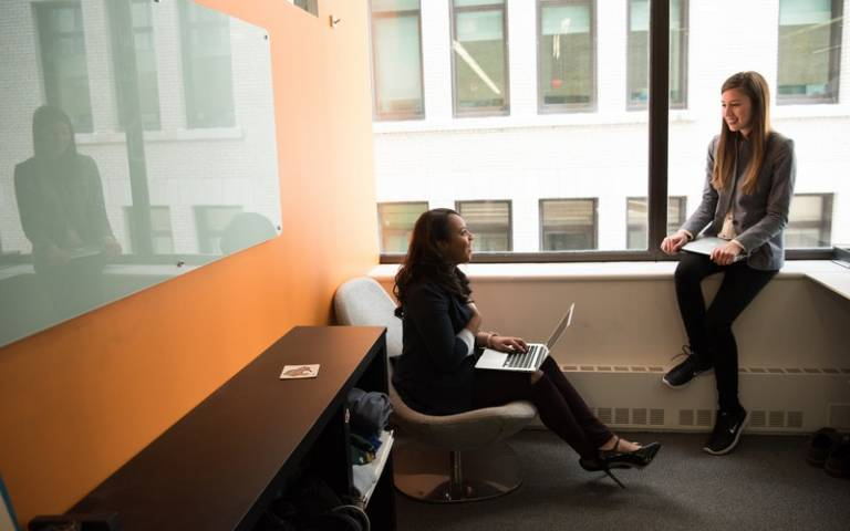 Two women sitting in the office. Image: Christina Morillo via Pexels