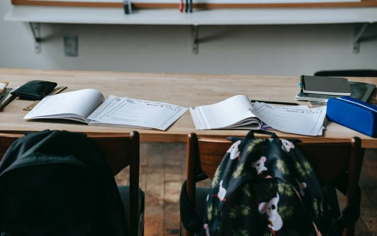 Workbooks and papers on classroom table. Image:Katerina Holmes via Pexels