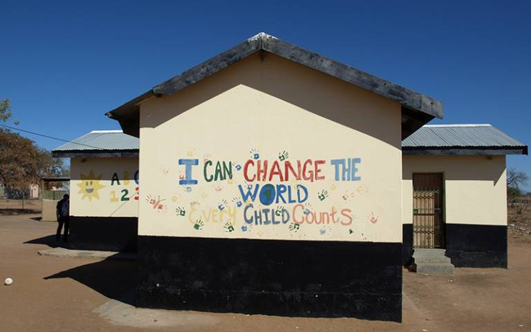 """I can change the world - every child counts"" written on a school wall in an African country"