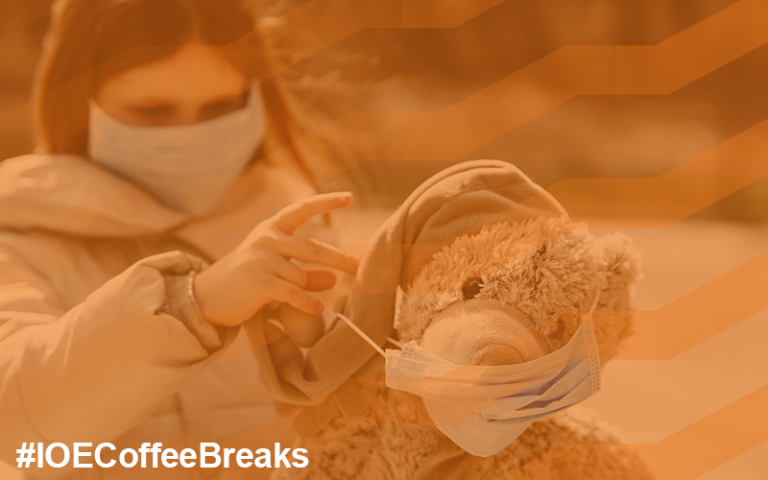 #IOECoffeeBreaks on image of a girl dressing a teddy bear in a disposable face mask