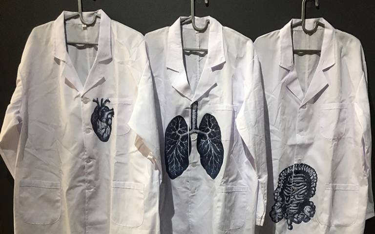 Lab coats printed with a heart, lungs, and intestines