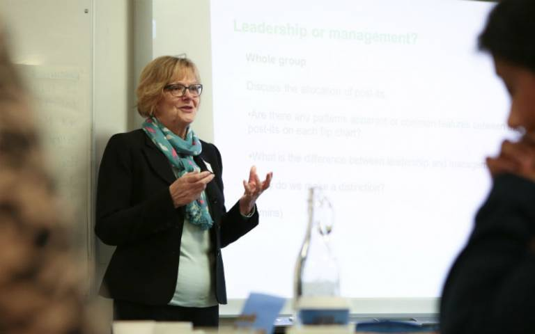 Woman delivering class on leadership